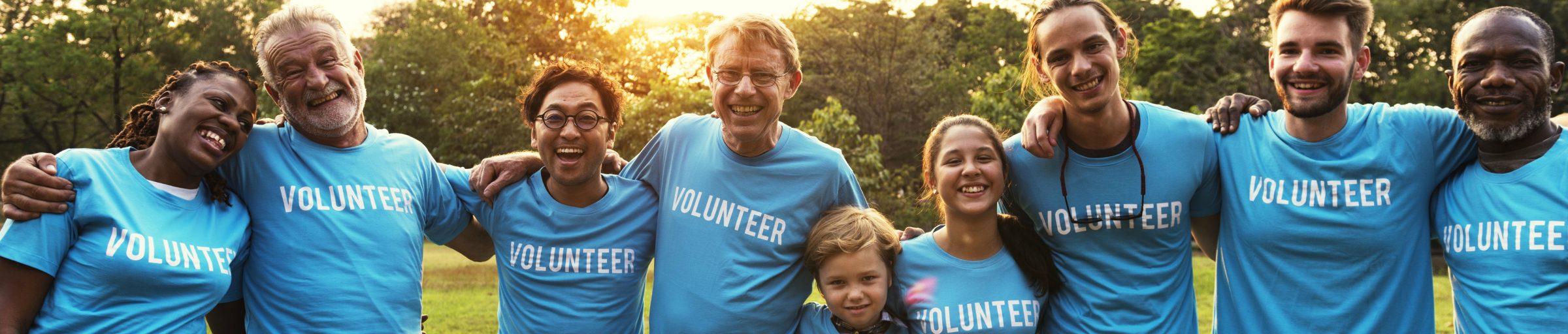 Group of people in volunteer tshirts